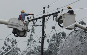 Bucket Truck In Ice Storm Repairing Power